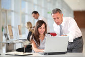 Manager and secretary working in the office — Stock Photo