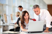 Manager and secretary working in the office — Stockfoto