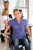 Closeup of young handicapped worker in the office — Stock Photo