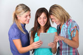 Friends playing with electronic pad — Stock Photo