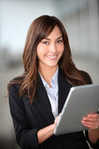 Closeup of beautiful businesswoman with electronic tablet — Stock Photo
