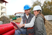 Architect an site supervisor on construcion site — Stock Photo