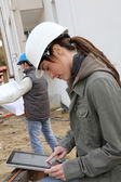 Woman engineer with white security helmet standing on construction site — Stock Photo
