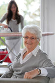 Closeup of elderly woman with home help — Stock Photo