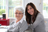 Closeup of elderly woman with young woman — Stock Photo