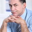 Closeup of tired businessman in the office — Stock Photo