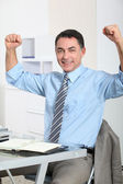 Man in the office showing positivity — Stock Photo