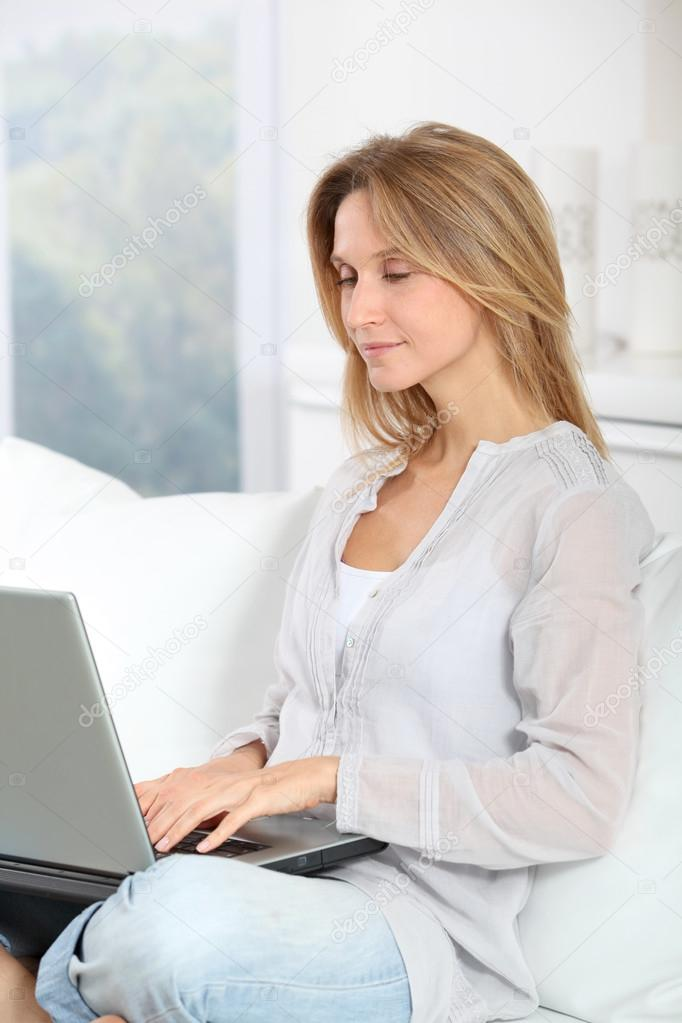 Beautiful blond woman surfing on internet at home  Stock Photo #18249833