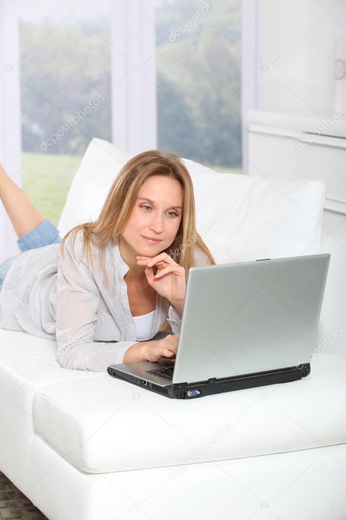 Beautiful blond woman surfing on internet at home  Stock Photo #18249849