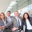 Group of happy business with arms up — Stock Photo #18251387