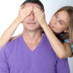 Woman hiding eyes of her boyfriend — Stock Photo #18250273