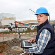 Engineer on construction site with laptop computer — Stock Photo