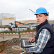 Engineer on construction site with laptop computer — Stock Photo #18250721
