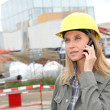 Architect on construction site with security helmet — Stock Photo