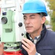 Geometer with measure instrument - Stock Photo
