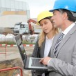 Business on construction site — Stock Photo