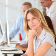 Beautiful woman working in the office on laptop computer — Stock Photo #18251199