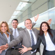 Stock Photo: Group of happy business with arms up