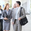 Business walking outside a congress center — Stock Photo