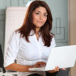 Beautiful businesswoman with laptop computer — Stock Photo