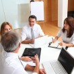Business meeting around table — Stock Photo #18251591