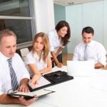 Business meeting around table — Stock Photo #18251601
