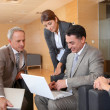 Group of associates meeting in lounge — Stock Photo #18251613