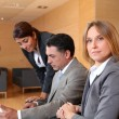 Group of associates meeting in lounge — Stock Photo #18251621