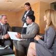 Group of associates meeting in lounge — Foto Stock