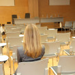 Businesswoman waiting in conference room - Stock Photo