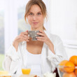 Stock Photo: Woman having breakfast in the morning