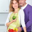 Royalty-Free Stock Photo: Couple in kitchen with bowl of vegetables