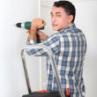 Man using electric drill at home — Stock Photo #18252259
