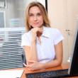 Woman working in the office — Stock Photo