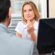 Man meeting financial adviser in office — Stock Photo