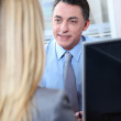 Woman meeting financial adviser in office — Stock Photo