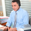 Adult man in the office talking on the phone — Stock Photo