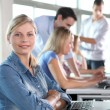 Closeup of blond woman attending training course — Stock Photo #18253507
