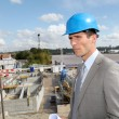 Businessman controlling site under construction - Stock Photo
