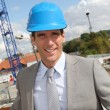 Businessman controlling site under construction — Stock Photo
