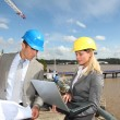 Architect and supervisor checking site under construction — Stock Photo