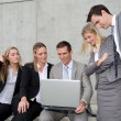 Group of five business meeting in front of building — Stock Photo