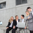 Stock Photo: Group of five business meeting in front of building