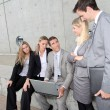 Group of five business meeting in front of building — Stock Photo #18253623