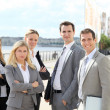 Group of business standing outside a trade fair — Stock Photo