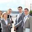 Group of business standing outside a trade fair — Stock Photo #18253811