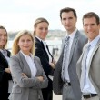 Group of business standing outside a trade fair — Stock Photo #18253817