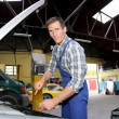 Repairer working on vehicle in garage — Stock Photo