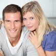 Smiling couple standing in home kitchen — Stock Photo