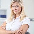 Beautiful smiling young woman working in the office — Stock Photo #18254307